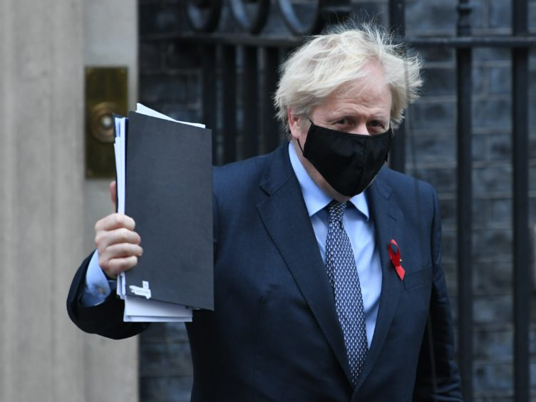 Prime Minister Boris Johnson leaving Downing Street on Tuesday to vote on the new coronavirus restrictions (Stefan Rousseau/PA)