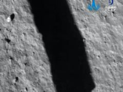In this image taken by a camera aboard Chang'e 5 spacecraft provided by China National Space Administration, its shadow is reflected on the surface of the moon (China National Space Administration/AP)