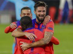 Olivier Giroud celebrates with team-mates (Angel Fernandez/AP)
