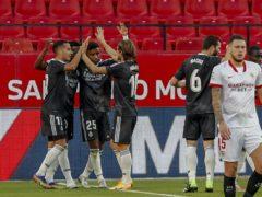 Real Madrid's players celebrate their winner at Sevilla (Angel Fernandez/AP/PA)