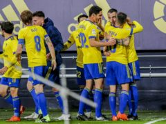 Alvaro Negredo, second right, celebrates the winner (Alvaro Rivero/AP)