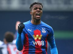 Crystal Palace's Wilfried Zaha celebrates the opener at West Brom (Alex Livesey/PA)