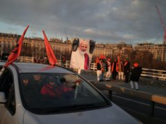 Demonstrators on Waterloo Bridge in London protesting against the exploitation of farmers in India (Aaron Chown/PA)