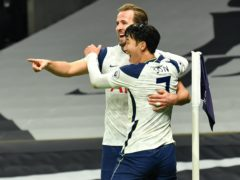 Harry Kane celebrates scoring his side's second goal of the game with team-mate Son Heung-min (Glyn Kirk/PA).