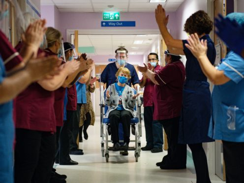 Margaret Keenan, 90, is applauded by staff (Jacob King/PA)
