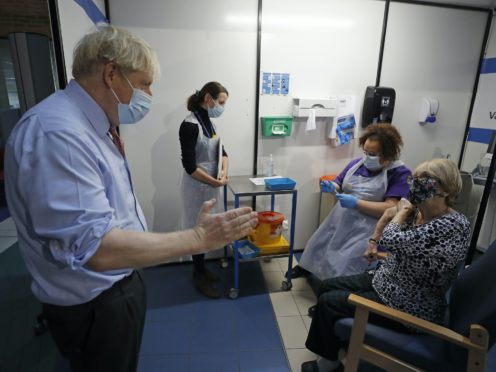 Prime Minister Boris Johnson speaks to nurse Rebecca Cathersides (second right) and Lyn Wheeler (right) at Guy's Hospital in London (Frank Augstein/PA)