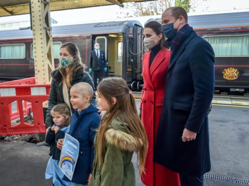 The Duke and Duchess of Cambridge take time to meet the Warner family (Ben Birchall/PA)