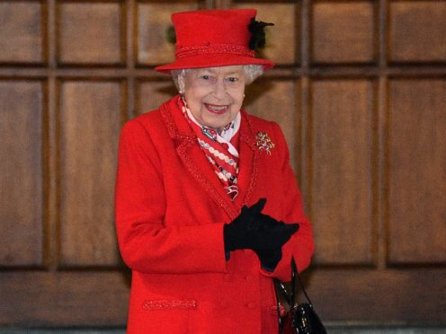 The Queen stands in the quadrangle at Windsor Castle to meet and thank members of the Salvation Army and local volunteers and key workers (Glyn Kirk/PA)