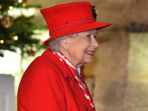 The Queen stands in the quadrangle at Windsor Castle to meet and thank members of the Salvation Army and local volunteers and key workers from organisations and charities in Berkshire (Glyn Kirk/PA)