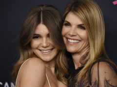 Lori Loughlin's daughter Olivia Jade Giannulli has broken her silence on the college admissions scandal which saw her actress mother and fashion designer father jailed (Chris Pizzello/Invision/AP, File)
