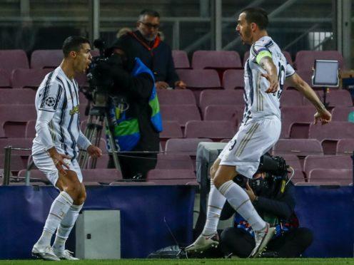 Juventus' Cristiano Ronaldo celebrates his first goal against Barcelona. (Joan Monfort/PA)