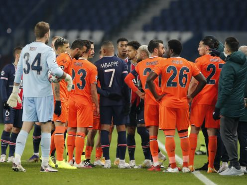Players from both sides leave the field during Paris St Germain's Champions League tie against Istanbul Basaksehir (Francois Mori/AP)