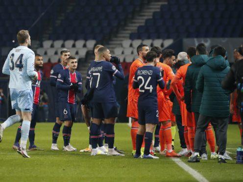 Paris S Germain and Istanbul Basaksehir players walk off the pitch (Francois Mori/AP).