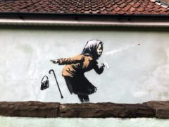 A Banksy-style artwork has appeared on a wall in Vale Street, Bristol (Claire Hayhurst/PA)