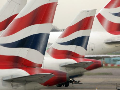 British Airways has cut more than 15 long-haul routes due to operate next year (Tim Ockenden/PA)
