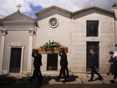 A funeral takes place in Montepagano, central Italy (Domenico Stinellis/AP)