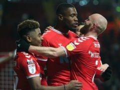 Chuks Aneke (centre) celebrates scoring Charlton's fourth goal (Steven Paston/PA)