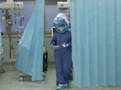 A nurse walks inside a Covid-19 intensive care unit of the Tor Vergata Polyclinic Hospital in Rome (Alessandra Tarantino/AP)