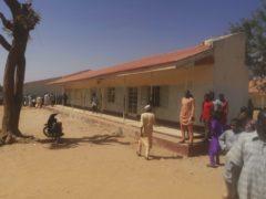 People gather inside the Government Science Secondary School in Kankara, Nigeria (Abdullatif Yusuf/AP)