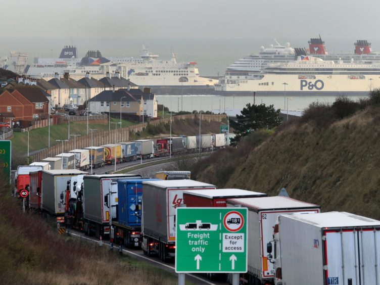 Lorries queue for The Port of Dover along the A20 in Kent (PA)