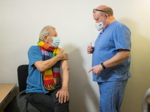 Sir Ian McKellen is one celebrity to have received the Covid-19 vaccine (Jeff Moore/PA)