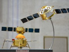 A model of China's Chang'e 5 lunar orbiter and lander are displayed before a press conference at the State Council Information Office in Beijing (Mark Schiefelbein/AP)