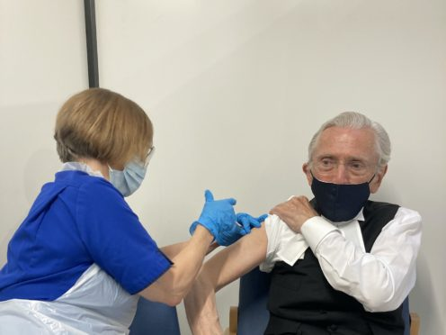 Lord Speaker, Lord Fowler, receiving the first dose of the Covid-19 vaccination (UK Parliament/PA)