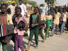 More than 300 schoolboys kidnapped last week in an attack on their school in north-west Nigeria have arrived in the capital of Katsina state to celebrate their release (Sunday Alamba/AP)