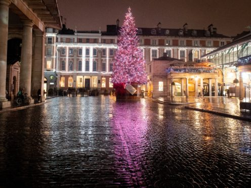 General view of the Christmas tree at a quiet Covent Garden Piazza, in central London, which is currently under Tier 4 coronavirus restrictions. Prime Minister Boris Johnson cancelled Christmas for almost 18 million people across London and eastern and south-east England following warnings from scientists of the rapid spread of the new variant of coronavirus.