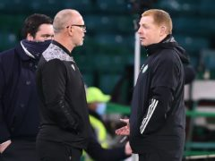 Neil Lennon, right, saw his Celtic side beat John Hughes' Ross County (Jeff Holmes/PA)