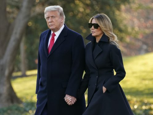 President Donald Trump and first lady Melania Trump walk to board Marine One on the South Lawn of the White House (Evan Vucci/AP)