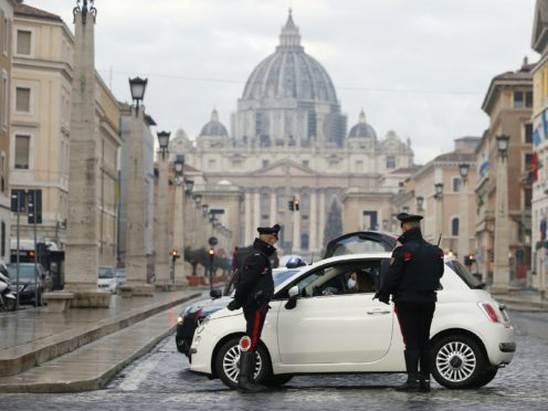 Italian carabinieri officers check vehicles in front of St Peter's Basilica at the Vatican (Cecilia Fabiano/AP)