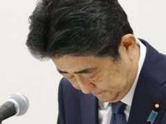 Former Japanese prime minister Shinzo Abe bows during a press conference in Tokyo (AP)