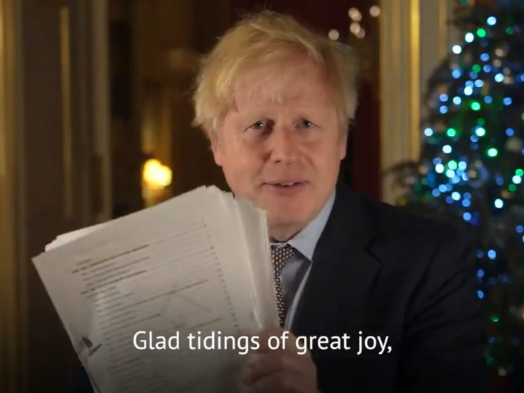 Boris Johnson has hailed the trade deal with the EU as 'glad tidings of great joy (@borisjohnson/PA)