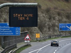 Cars make their way past a Tier 4 sign (PA)