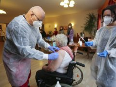 A nursing home resident is vaccinated in Halberstadt, Germany (Matthias Bein/dpa Via AP)