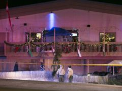 Police investigate a shooting at a bowling alley (Scott P. Yates/Rockford Register Star via AP)