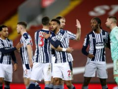 West Brom celebrate a hard-earned point after the final whistle at Liverpool (Clive Brunskill/PA)