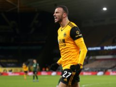 Romain Saiss celebrates Wolves' equaliser (Carl Recine/PA).