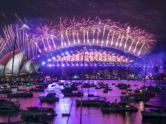 Fireworks explode over the Sydney Opera House and Harbour Bridge as New Year celebrations begin in Australia (Mark Baker/AP)