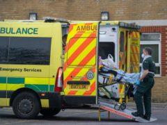 A patient arrives by ambulance at Southend University hospital (Joe Giddens/PA)