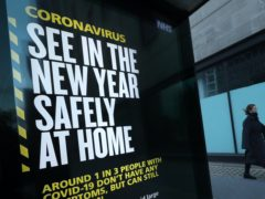 A coronavirus sign in Westminster, London (Yui Mok/PA)