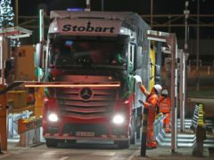 The first lorry, driven by Slavi Ivanov Shumeykov, has loaded onto Le Shuttle at the Eurotunnel in Folkestone, Kent, after the UK leaves the single market and customs union, and transitional trading arrangements expired at 11pm UK time (PA)