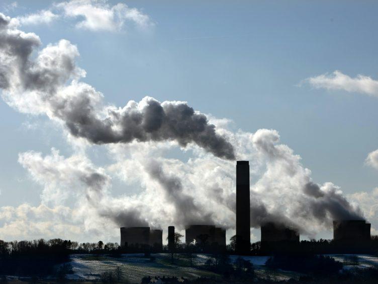 Boris Johnson has pledged to cut UK emissions by at least 68% by 2030 (David Jones/PA)