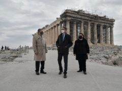 Greek Prime Minister Kyriakos Mitsotakis, center, Culture Minister Lina Mendoni, right, and President of the Onassis Foundation, Antonis Papadimitriou, stand in front of the of the Parthenon Temple, following the restoration of the Acropolis archaeological site in order to become fully accessible to people with disabilities (Louisa Gouliamaki/AP)