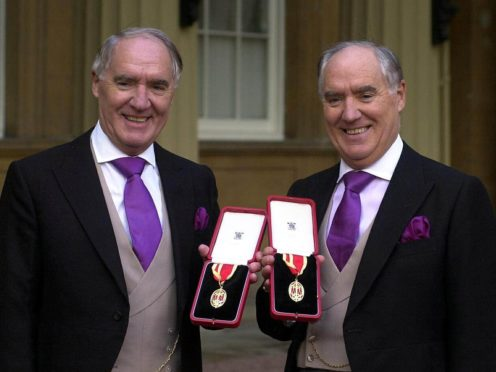 Sir David Barclay (left) and his twin brother Sir Frederick after receiving their knighthoods in 2002 (Michael Stephens/PA)