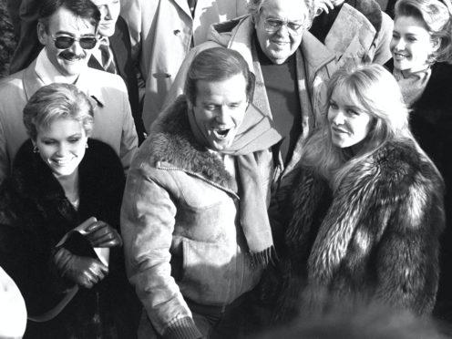 Fiona Fullerton, Roger Moore and Tanya Roberts (PA)