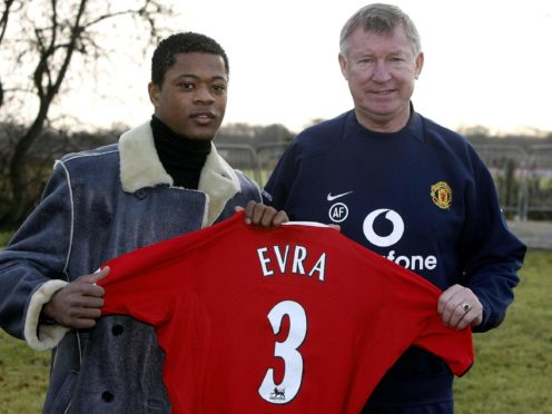 Patrice Evra with Manchester United manager Sir Alex Ferguson following his arrival from Monaco (Phil Noble/PA)