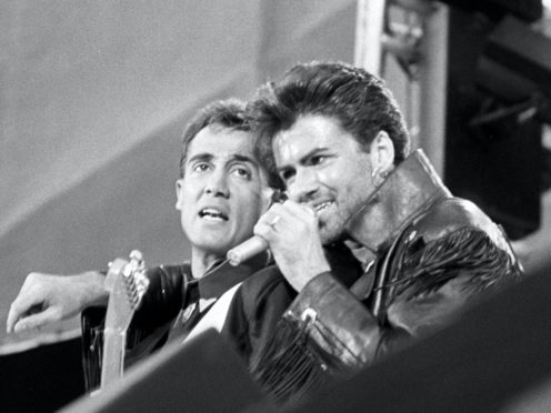 Pop duo Wham! – Andrew Ridgeley (left) and George Michael – on stage at Wembley Stadium in 1986 (PA)