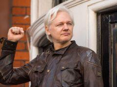 Julian Assange speaks from the balcony of the Ecuadorian embassy in London (Dominic Lipinski/PA)